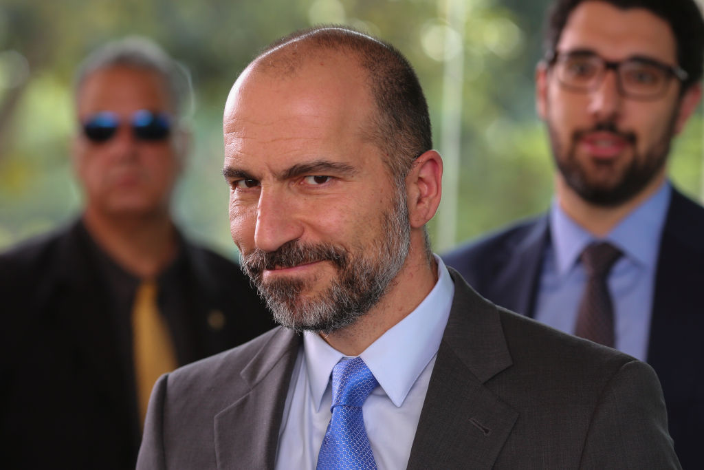 UBER's CEO Dara Khosrowshahi (R) smile