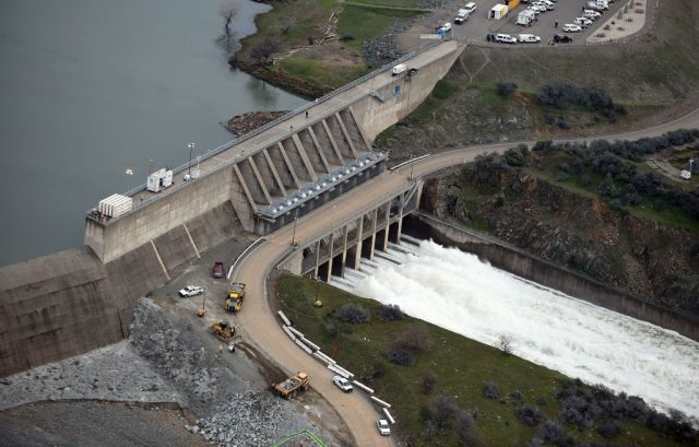 The Oroville Dam releases 100,000 cubic feet of water per second down the main spillway in Oroville, California