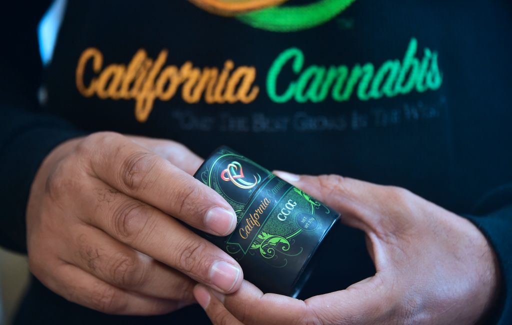 Cannabis entrepreneur Virgil Grant holds a 3.5 gram container for the medical marijuana