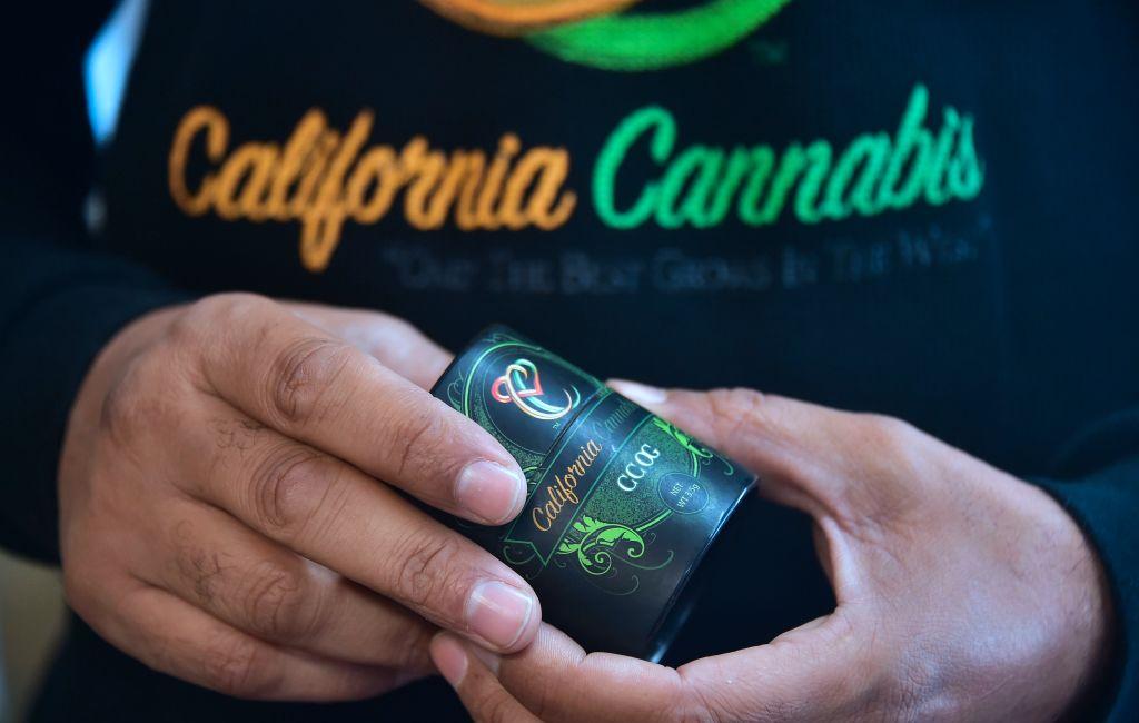 Cannabis entrepreneur Virgil Grant holds a 3.5 gram container for the medical marijuana