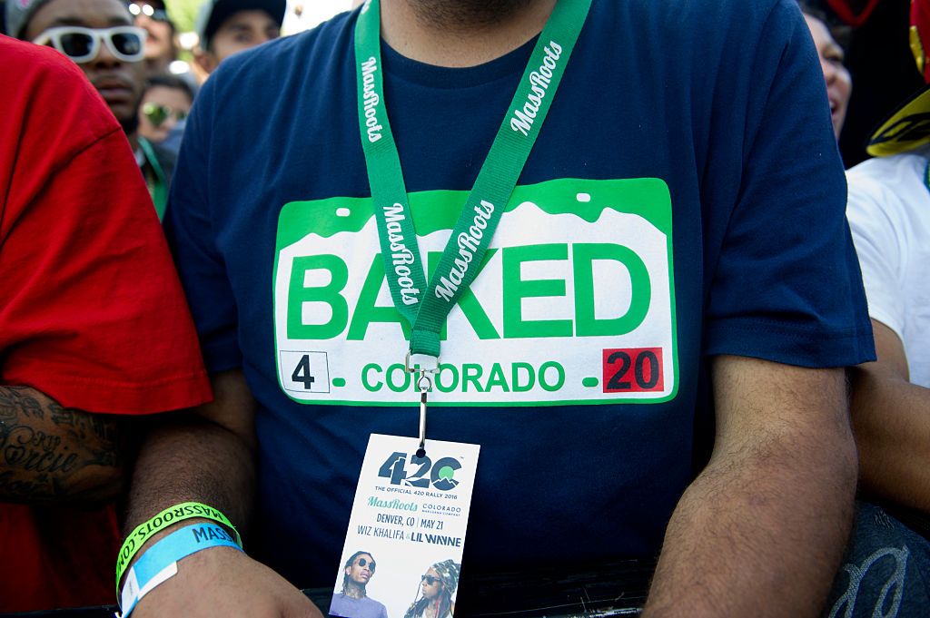 People attend the Denver 420 Rally, the world's largest celebration of both the legalization of cannabis and cannabis culture