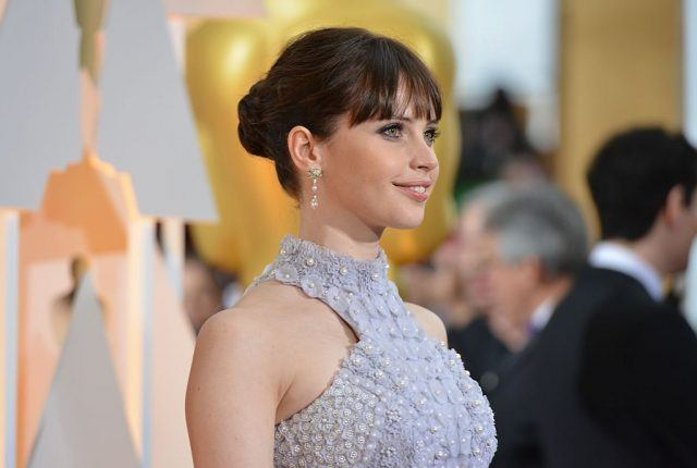Nominee for Best Actress Felicity Jones arrives on the red carpet for the 87th Oscars