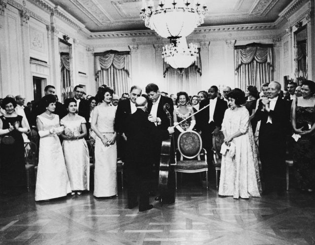American president John F. Kennedy (1917 - 1963) and his wife Jackie congratulate Spanish cellist Pablo Casals