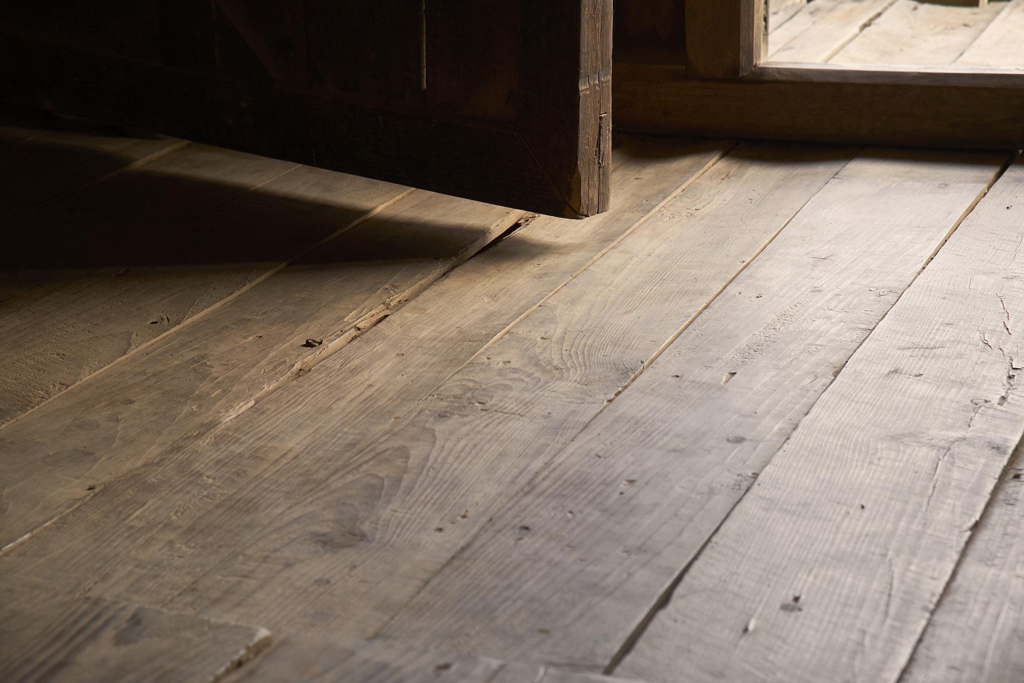 Uneven crooked floor with open door