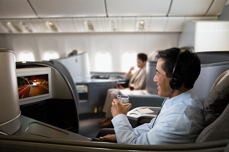 Man watching a movie in United Polaris first class