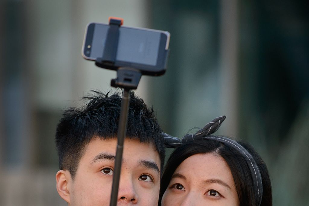 couple taking selfie with selfie stick