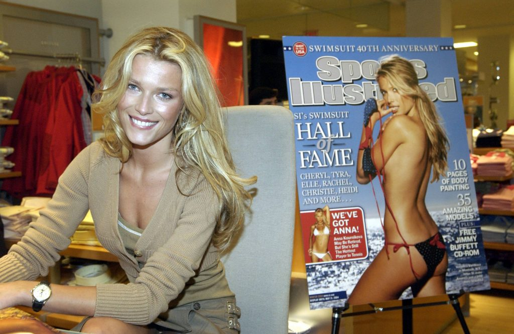 Model Veronica Varekova autographs copies of the 2004 Sports Illustrated Swimsuit issue.