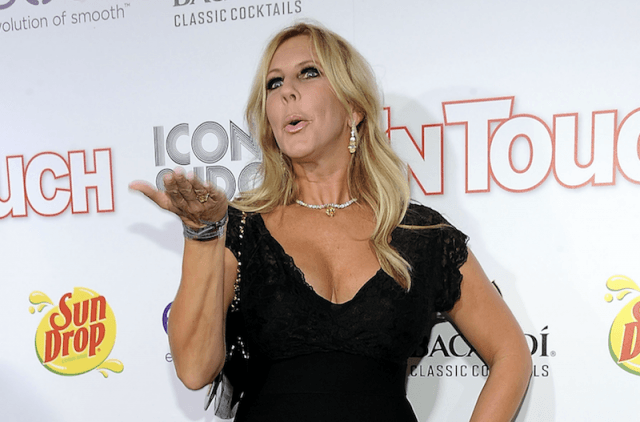 Vicki blows a kiss while posing on a red carpet.