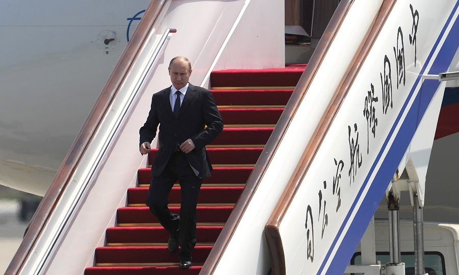 Russia's President Vladimir Putin disembarks from the airplane