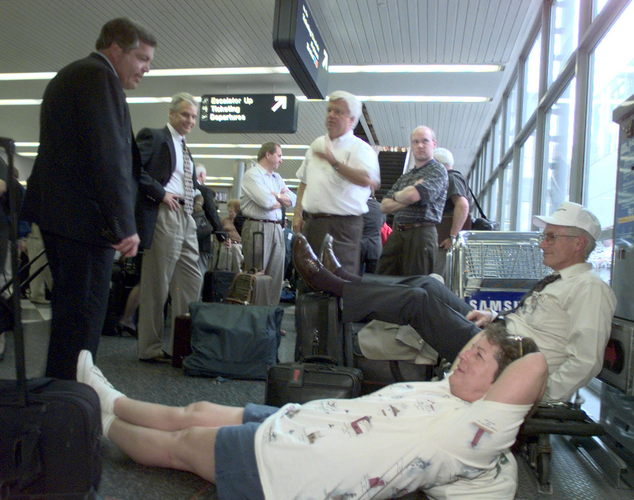 People wait at the airport in the 90s