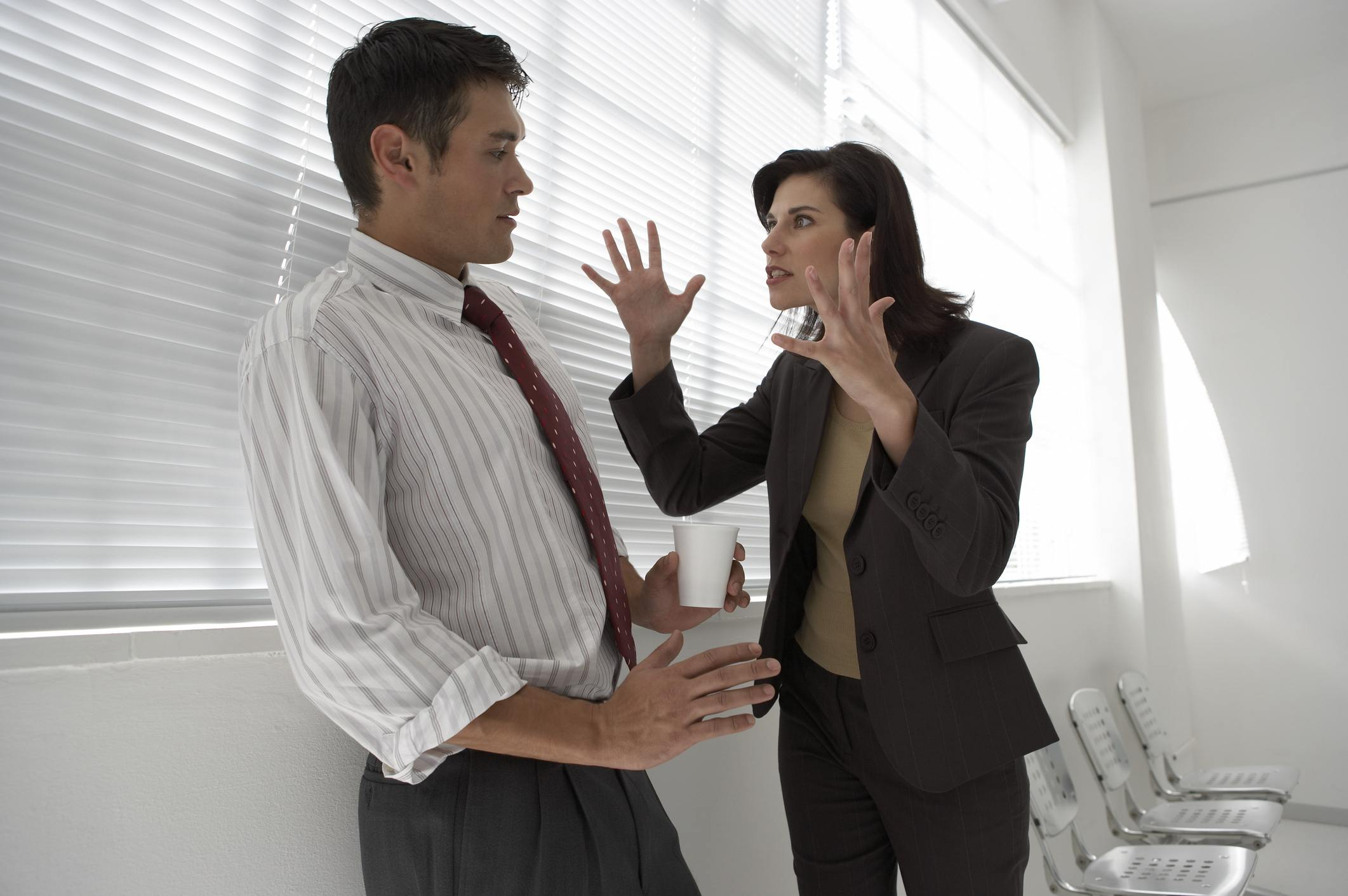 Angry Businesswoman yelling at a businessman