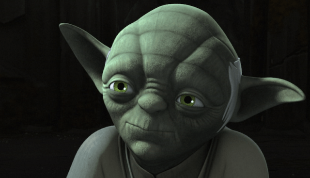 Yoda in front of a black background.