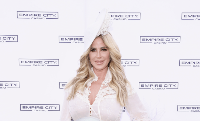 Zolciak-Biermann wearing white from head to toe on a red carpet.