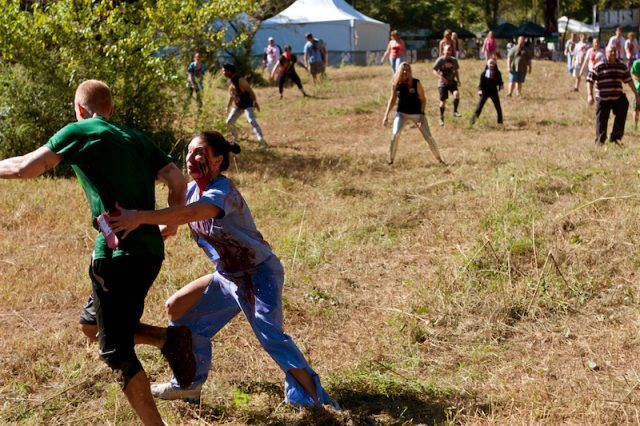 A zombie chasing a jogger.