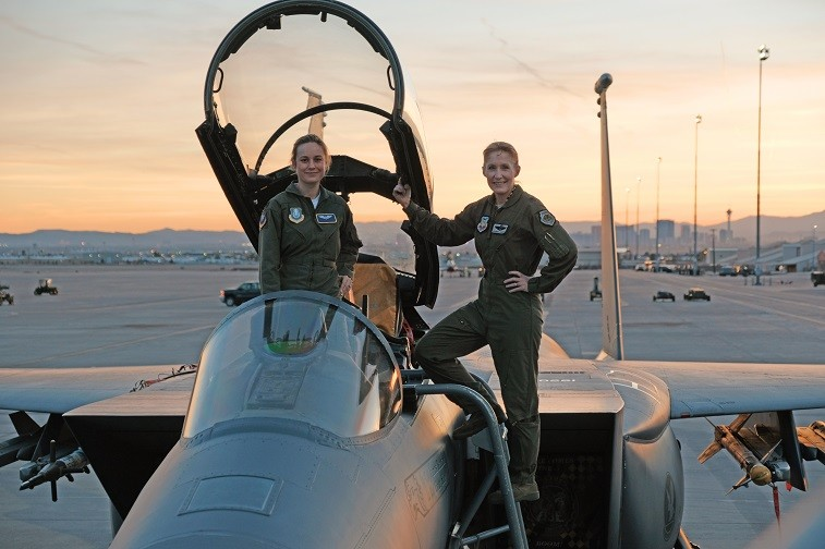 "Brie Larson (left) gets hands-on help from Brigadier General Jeannie Leavitt, 57th Wing Commander (right), on a recent trip to Nellis Air Force Base in Nevada to research her character, Carol Danvers aka Captain Marvel, for Marvel Studios' ""Captain Marvel."""