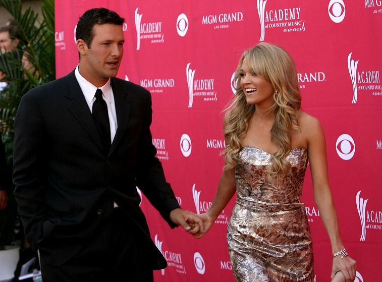 Singer Carrie Underwood and Quarterback Tony Romo of the Dallas Cowboys arrive at the 42nd Annual Academy Of Country Music Awards held at the MGM Grand Garden Arena on May 15, 2007 in Las Vegas, Nevada.