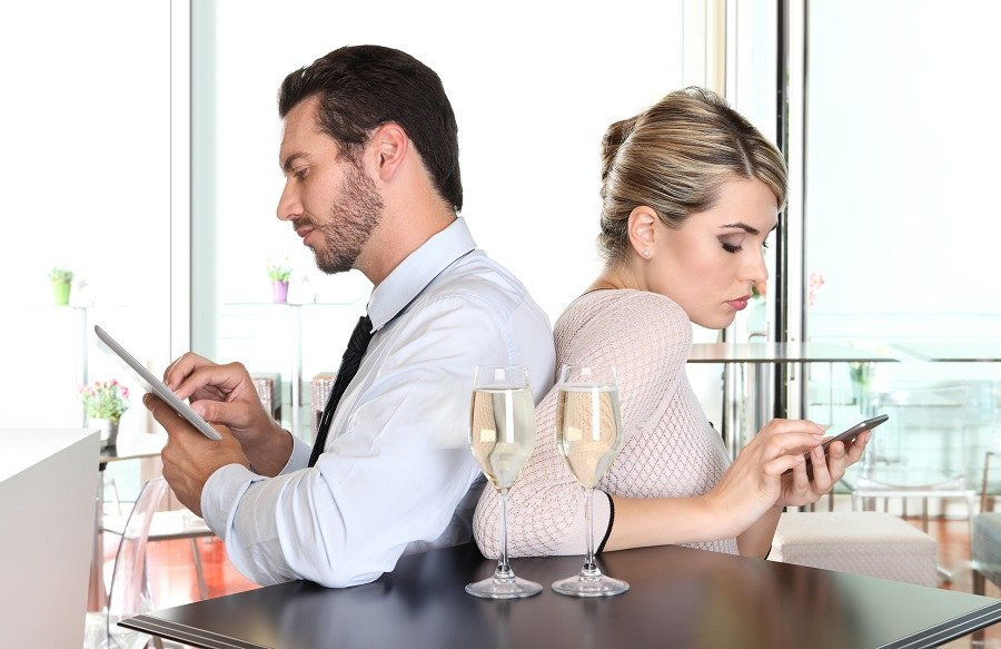 couple busy on mobile