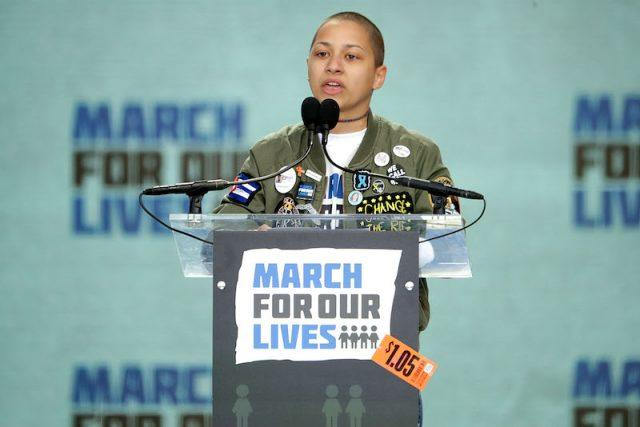 Emma Gonzalez speaking at a podium for 'March for Our Lives'.