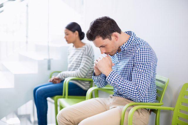 Two patient waiting at a hospital.