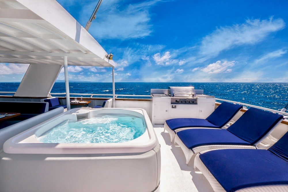 White steel yacht with white deck