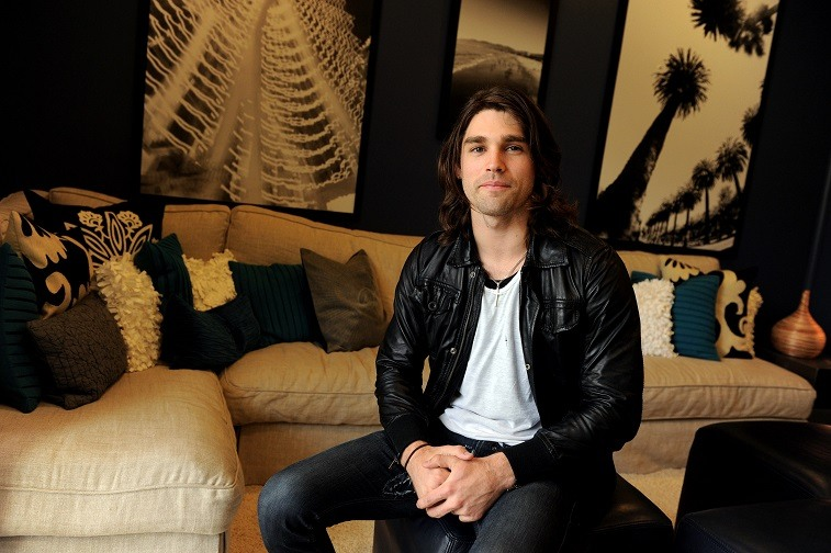 "Musician Justin Gaston poses at the ""If I Can Dream"" house tour and cast meet and greet at a private home in the Hollywood Hills on March 1, 2010 in Los Angeles, California."