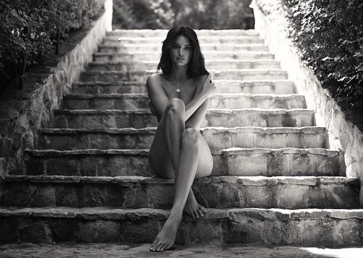 Kendall Jenner sitting nude on steps
