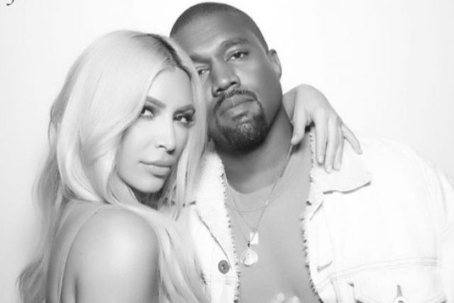 Kim Kardashian and Kanye West in a black and white photo.
