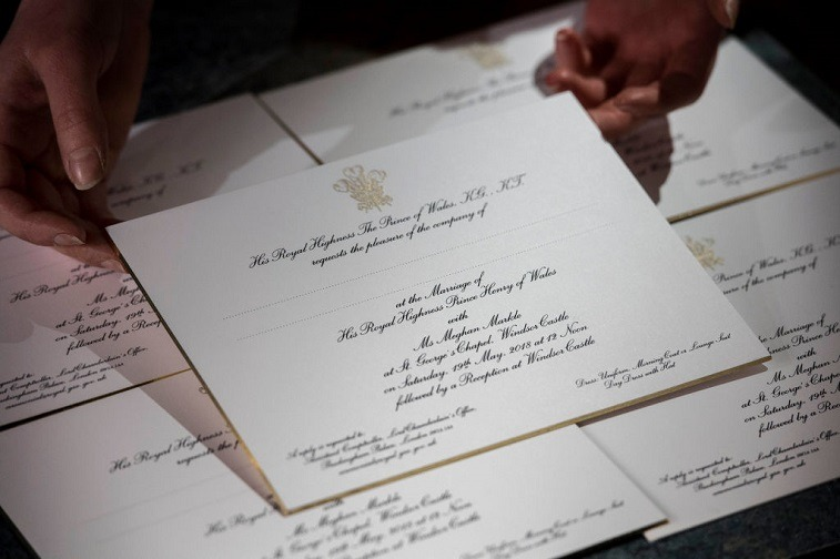 Hands Hold Invitations Just Printed At The Workshop Of Barnard And Westwood For Prince Harry