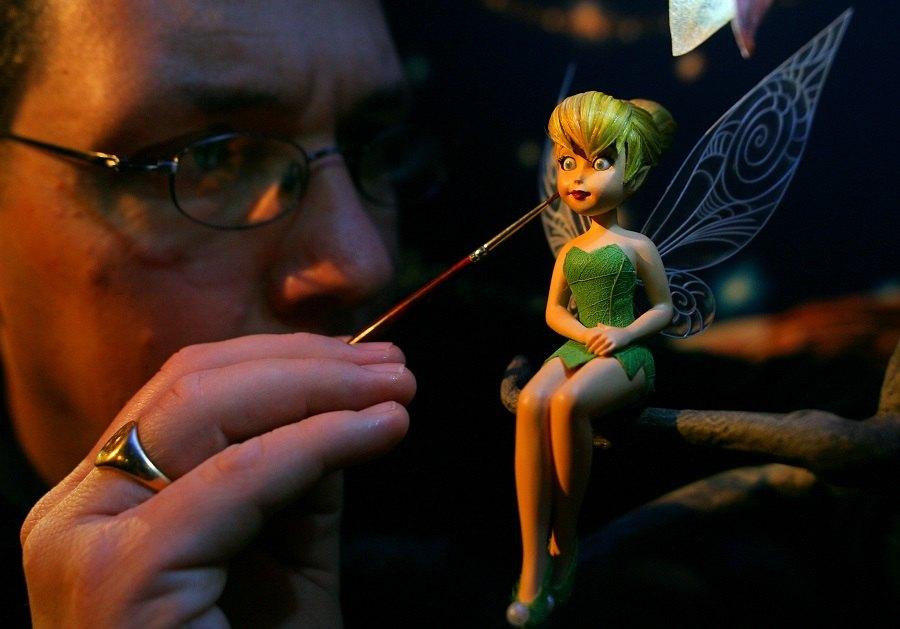 Sculptor Steven Mansfield arranges a fairy model