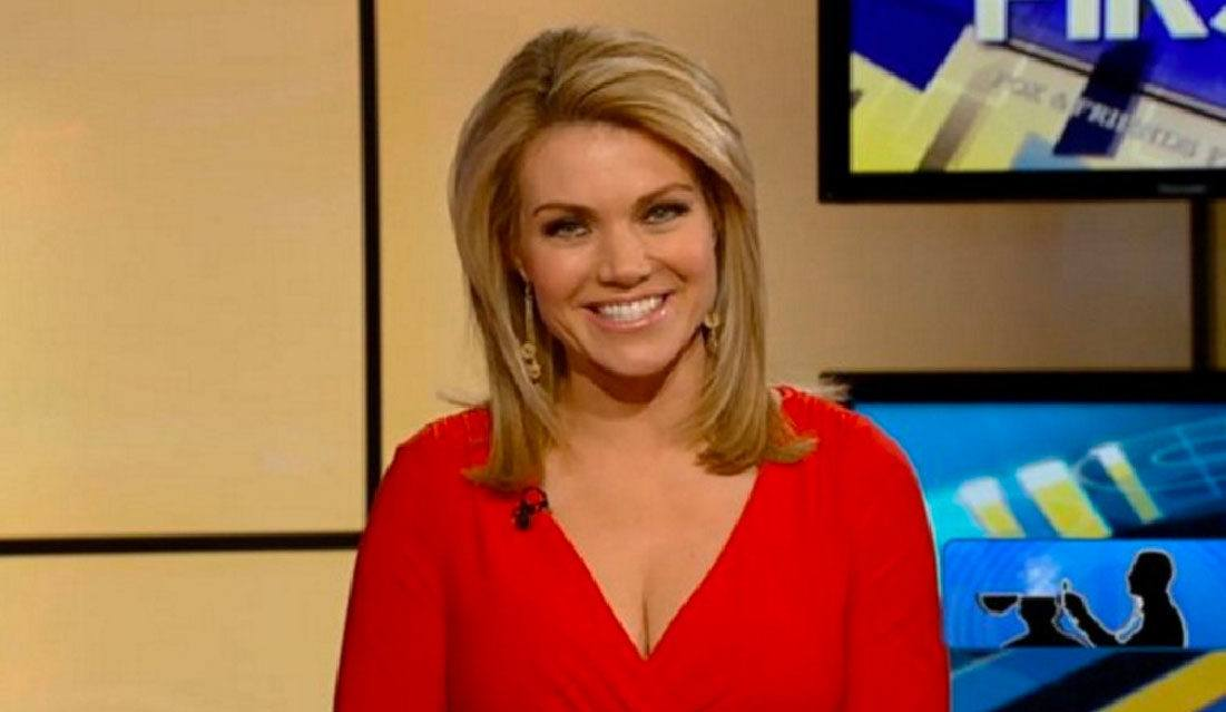 Heather Nauert smiles in a red shirt