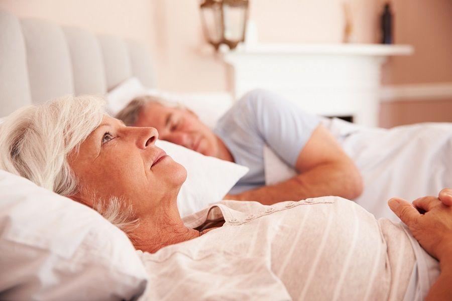 Worried Senior Woman Lying Awake In Bed