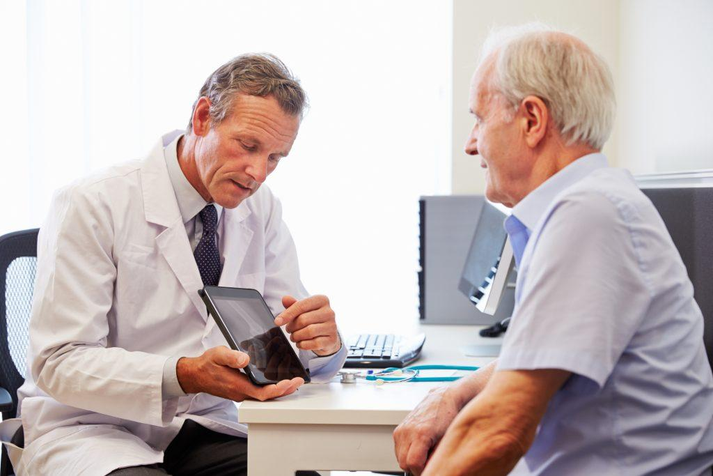 Senior patient talking to a doctor