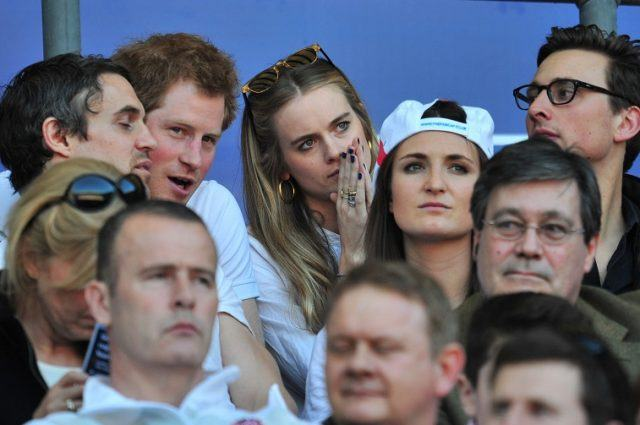 Britain's Prince Harry (2-L) and British socialite Cressida Bonas (3-L) watch the match during the Six Nations International rugby Union match between England and Wales at Twickenham, West London on March 9, 2014.