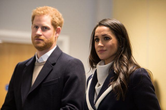 Prince Harry and Meghan Markle standing side-by-side.
