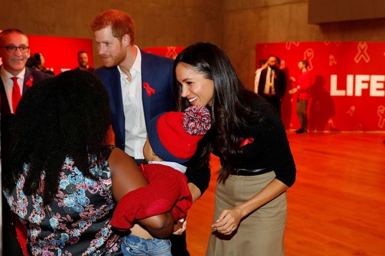 Prince Harry and his fiancee US actress Meghan Markle visit the Terrence Higgins Trust World AIDS Day charity fair at Nottingham Contemporary on December 1, 2017 in Nottingham, England. Prince Harry and Meghan Markle announced their engagement on Monday 27th November 2017 and will marry at St George's Chapel, Windsor in May 2018.