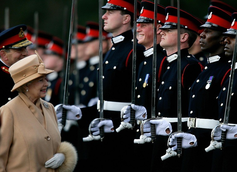 Britain's Queen Elizabeth II smiles with her grandson Prince Harry during the Sovereign's Parade at the Royal Military Academy in Sandhurst, southern England, April 12, 2006