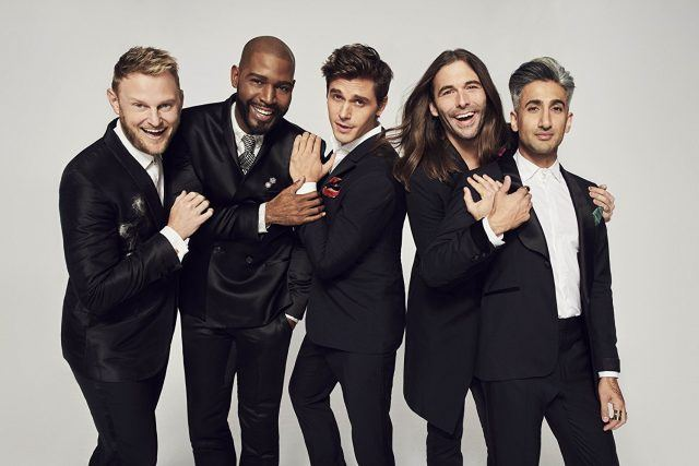 The 'Queer Eye' cast posing together in tuxedos.