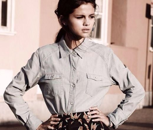 Selena Gomez in a denim shirt and skirt
