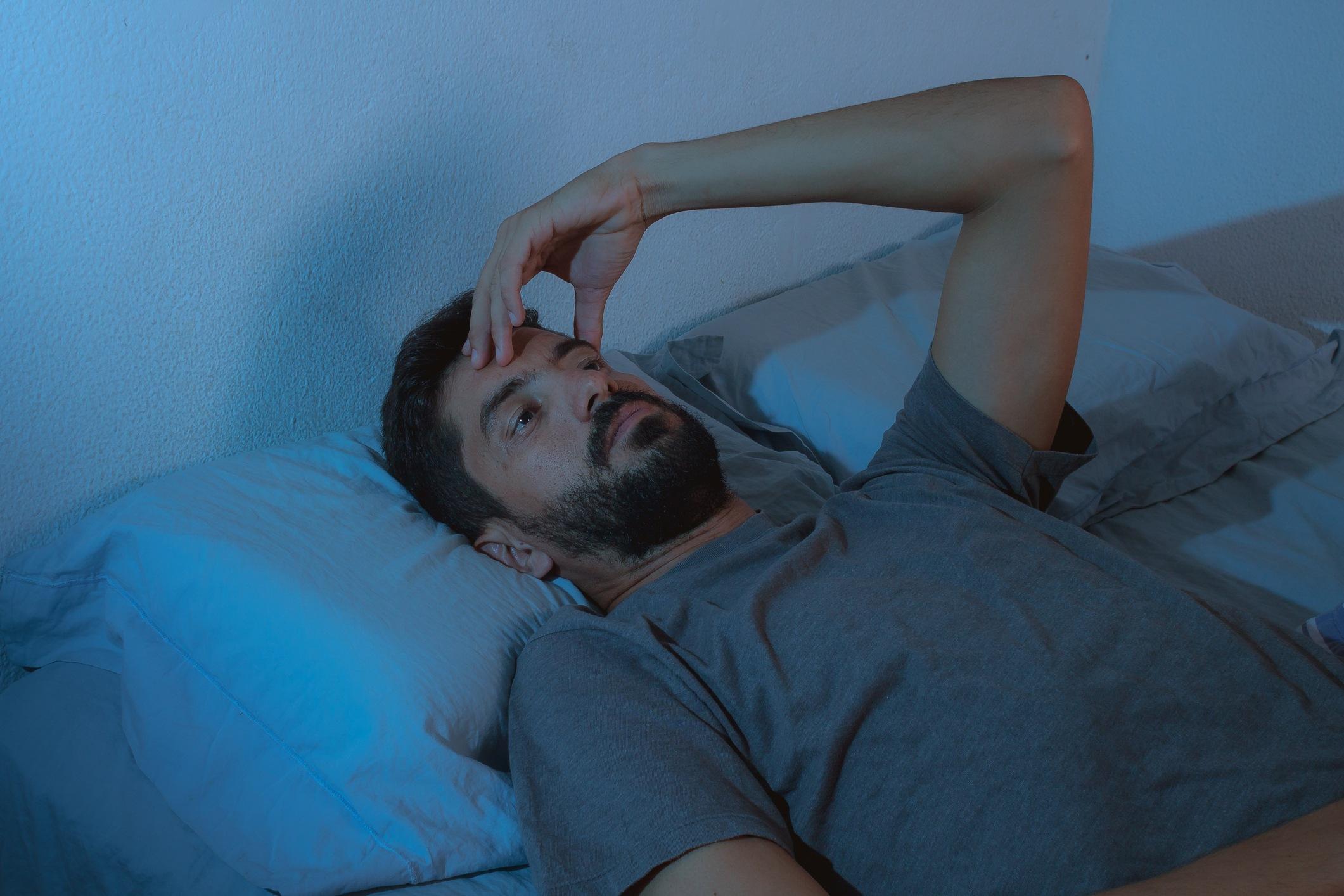 insomnia. young beard man lying