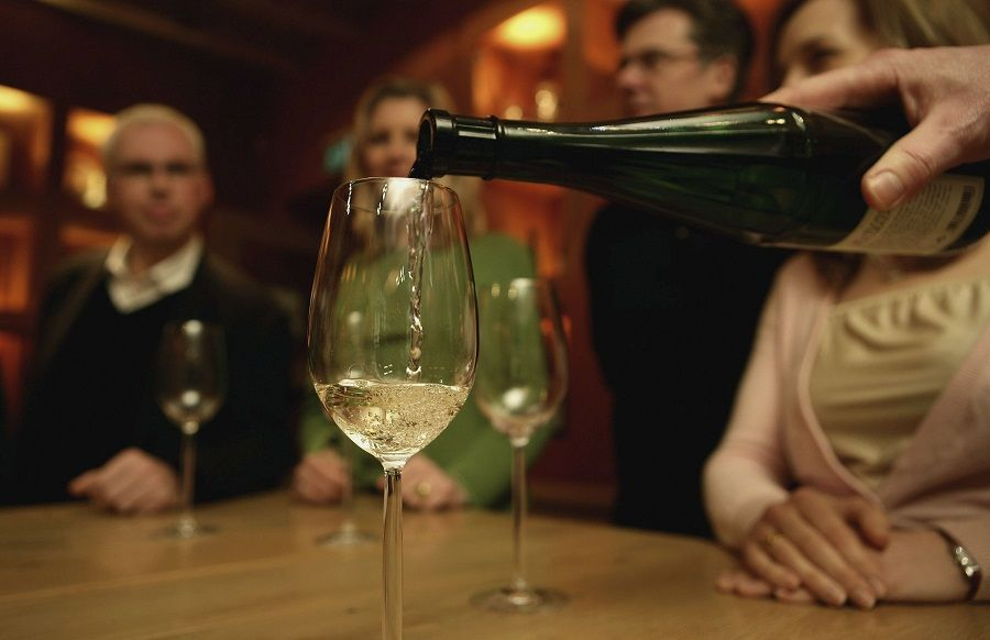 A glas is filled with Riesling wine