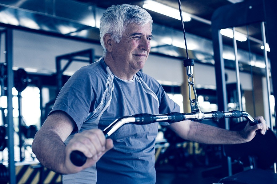 Active older man working out in the gym