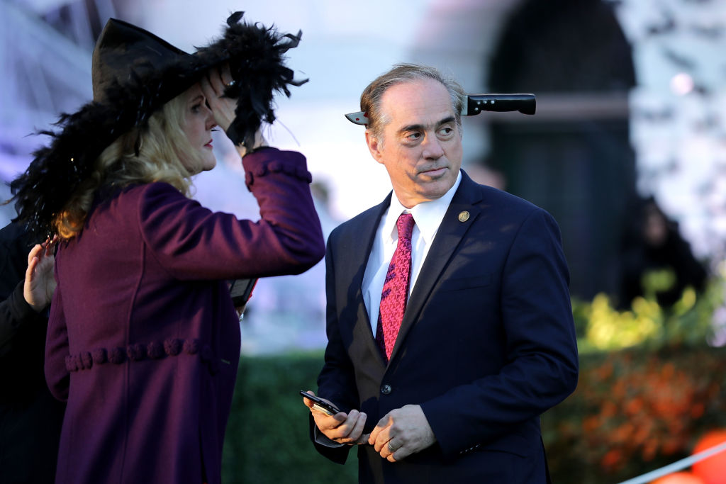 U.S. Secretary of Veterans Affairs David Shulkin (R) attends Halloween at the White House