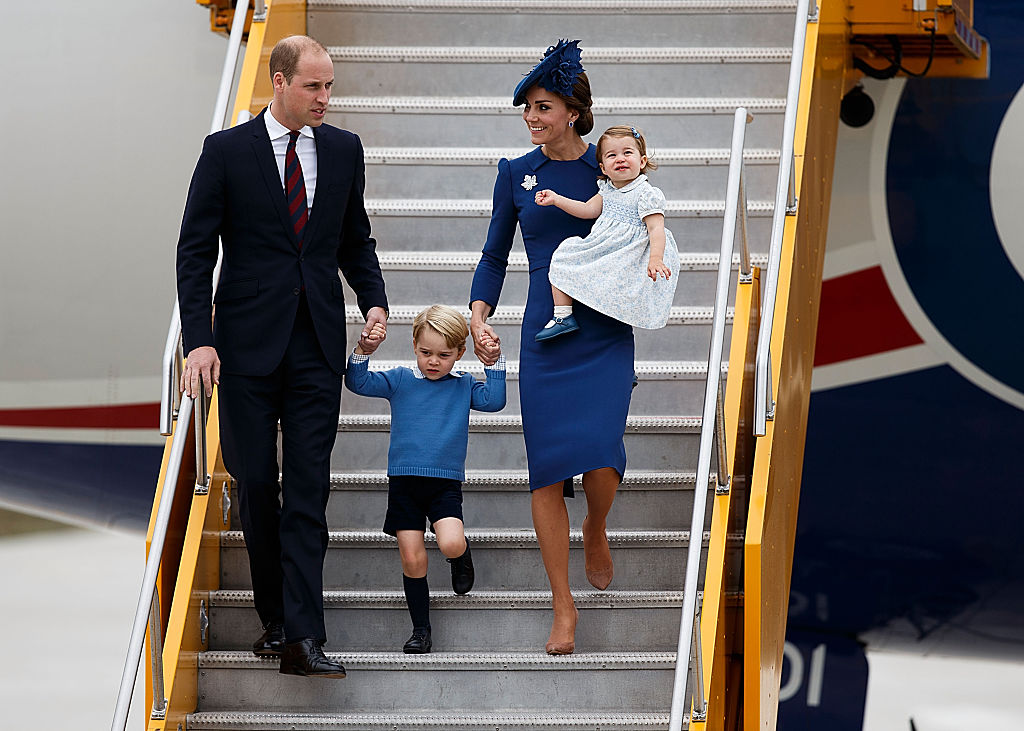 Prince William, Duke of Cambridge, Prince George of Cambridge, Catherine, Duchess of Cambridge and Princess Charlotte of Cambridge arrive at 443 Maritime Helicopter Squadron