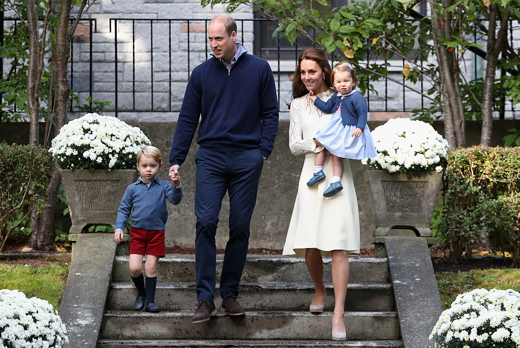 Catherine, Duchess of Cambridge, Princess Charlotte of Cambridge, Prince George of Cambridge and Prince William, Duke of Cambridge arrive for a children's party for Military families