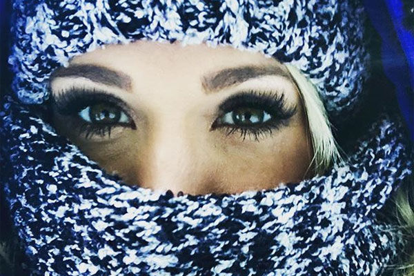 Carrie Underwood's face wrapped in a scarf