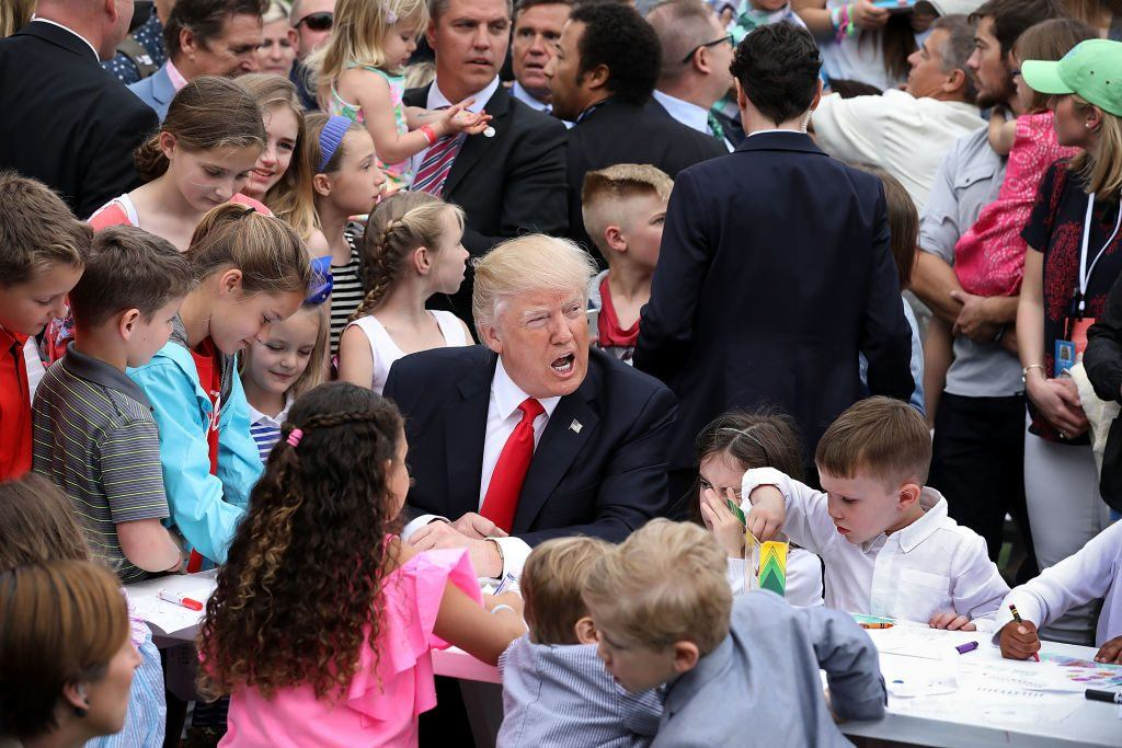 Trump with kids in a large crowd