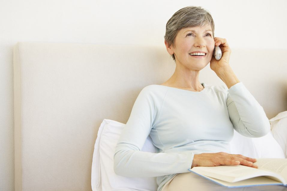 A senior woman talking on her cellular phone