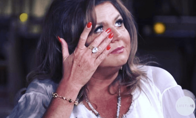 Abby Lee Miller cries on television.