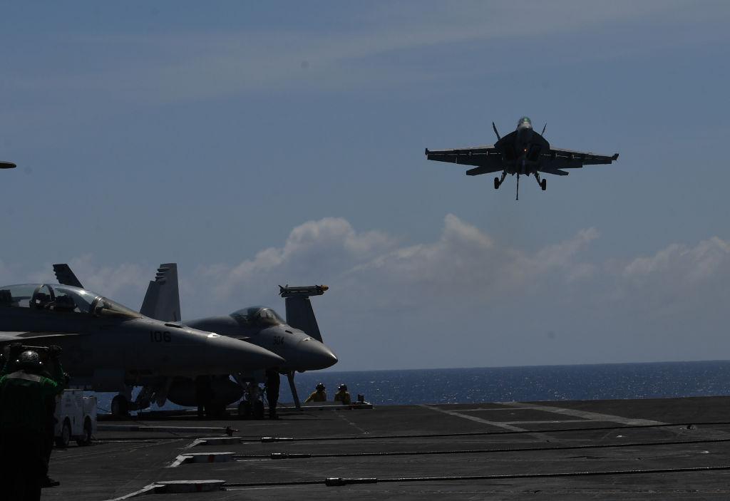 Fighter jet landing on an aircraft carrier