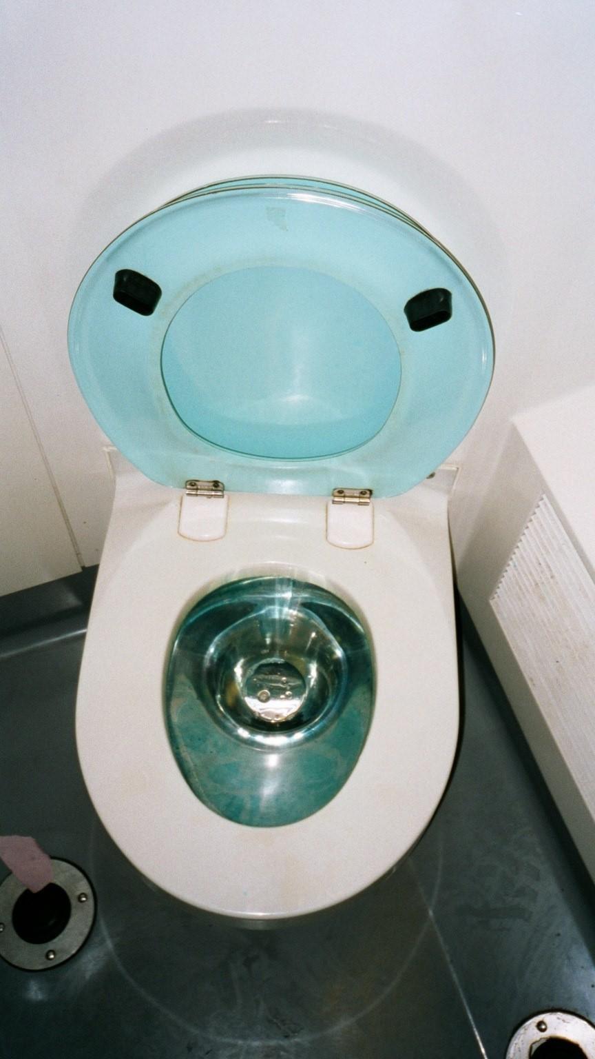 Airplane toilet blue water